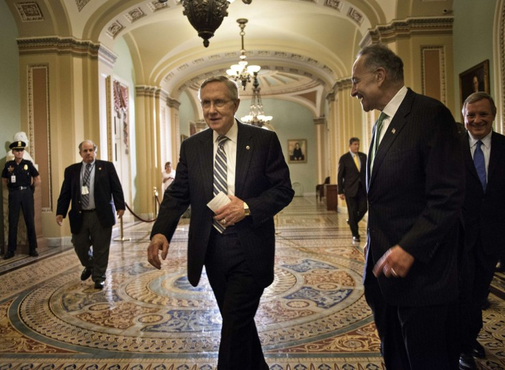 Senate Majority Leader Senator Harry Reid (C), D-NV, Senator Charles E. Schumer (2nd-R), D-NY, and Senate Democratic Whip Senator Richard Durbin (R), D-IL, walk from the Senate floor after a vote on Capitol Hill October 16, 2013 in Washington, DC. The US Senate passed legislation to compromise on budget and debt concerns to reopen the US federal government funding it to mid January address the debt limit till early February. (Brendan Smialowski/Getty Images)