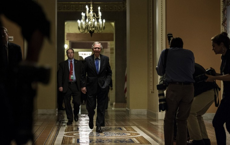 Senate Minority Leader Senator Mitch McConnell (R-KY) walks to a vote on Capitol Hill October 16, 2013 in Washington, DC. The US Senate passed legislation to compromise on budget and debt concerns to reopen the US federal government funding it to mid January address the debt limit till early February. Brendan Smialowski/ AFP Photo