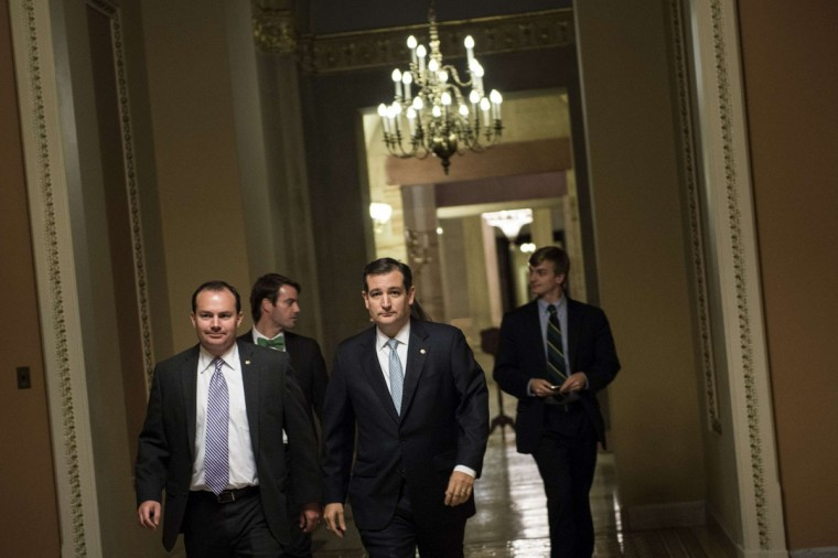 Senator Mike Lee (R-UT) (L) and Senator Ted Cruz (R-TX) walk to a vote on Capitol Hill October 16, 2013 in Washington, DC. The US Senate passed legislation to compromise on budget and debt concerns to reopen the US federal government funding it to mid January address the debt limit till early February.