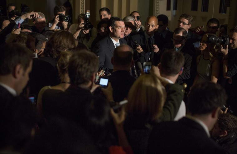 On the 16th day of a government shutdown, and with debt default hours away, Sen. Ted Cruz, R-Texas, speaks to reporters Wednesday while Senate Republicans work toward a solution to the federal gridlock. (Melina Mara/Washington Post)