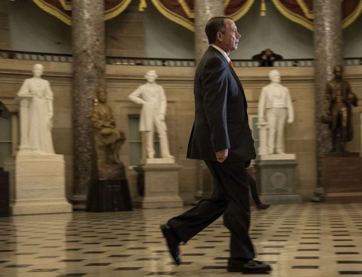 Speaker of the House John Boehner (R-OH) walks through Statuary Hall to a vote on Capitol Hill October 16, 2013 in Washington, DC. The House is voting on a bill passed by the US Senate to compromise on budget and debt concerns to reopen the US federal government funding it to mid January address the debt limit till early February. Brendan Smialowski/ AFP Photo