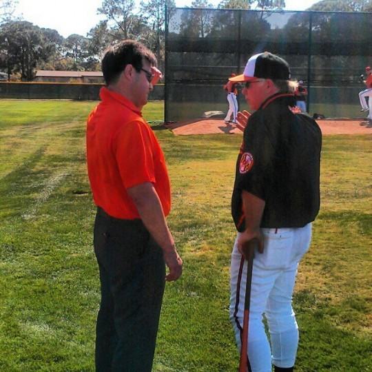 Dan Duquette chats with Buck Showalter as spring training gets under way in Sarasota on Feb. 13, 2013.