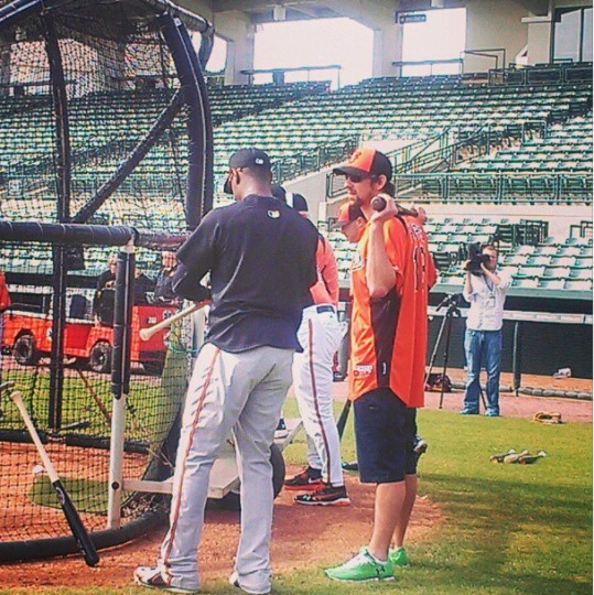 Swimmer Michael Phelps chats with Adam Jones during Orioles spring training on Feb. 21, 2013.