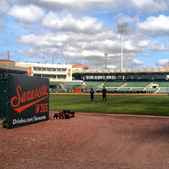The Orioles take batting practice at Ed Smith Stadium.