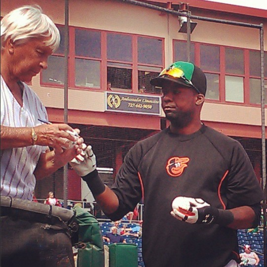 Wilson Betemit signs autographs at Ed Smith Stadium on March 17, 2013.