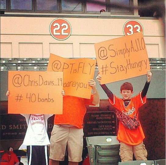 Orioles fans show their support for the team at Ed Smith Stadium in Sarasota on March 1, 2013.