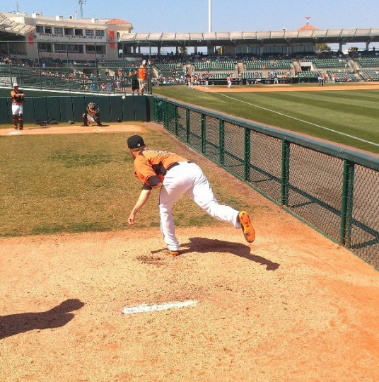 Orioles pitcher Chris Tillman throws in the bullpen at Ed Smith Stadium on March 29, 2013.