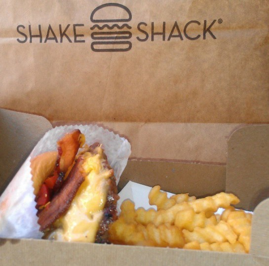 Eating at Shake Shack in New York on April 14, 2013.