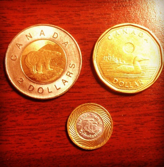 Looking at Canadian money on May 25, 2013.