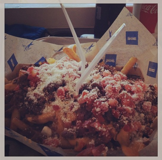 Enjoying carne asada fries at Petco Park in San Diego on Aug. 7, 2013.