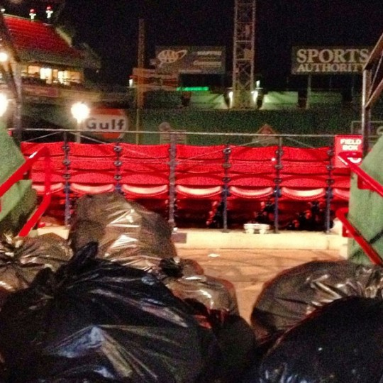 Cleanup is under way at Fenway Park in Boston after a game on Sept. 19, 2013.