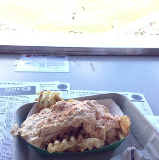 Enjoying some crab dip fries while sitting in the best seat in the house at Camden Yards on Sept. 29, 2013.