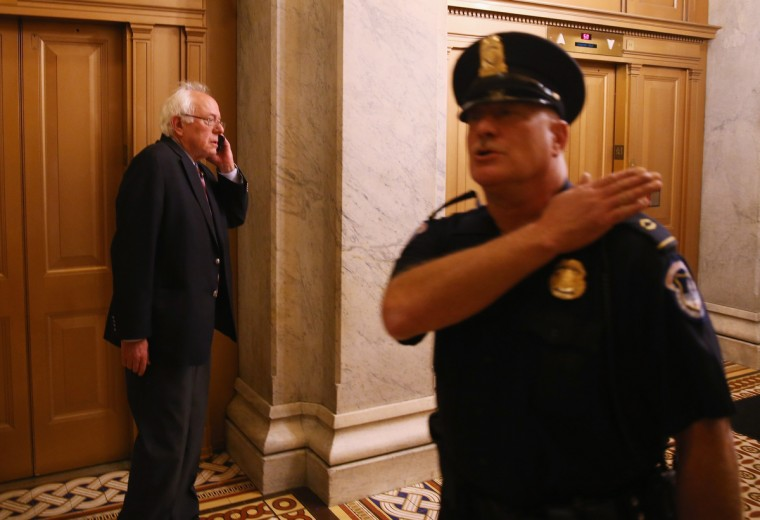 "Sen. Bernie Sanders (I-VT) speaks on the phone at the U.S. Capitol October 3, 2013 on Capitol Hill in Washington, DC. The US Capitol and the White House were placed on lockdown after an ""active shooter"" situation was reported. (Mark Wilson/Getty Images)"