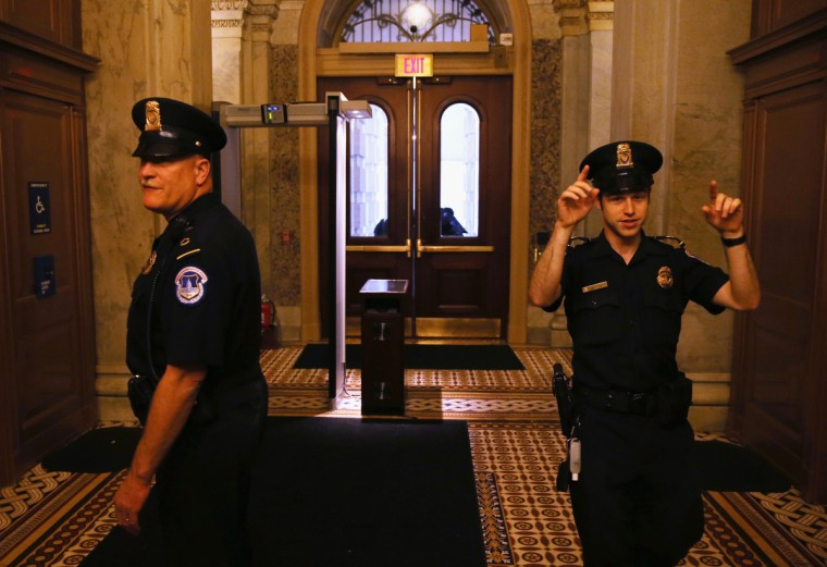 "Capitol Police enforce the lockdown at the U.S. Capitol October 3, 2013 on Capitol Hill in Washington, DC. The US Capitol and the White House were placed on lockdown after an ""active shooter"" situation was reported. (Mark Wilson/Getty Images)"