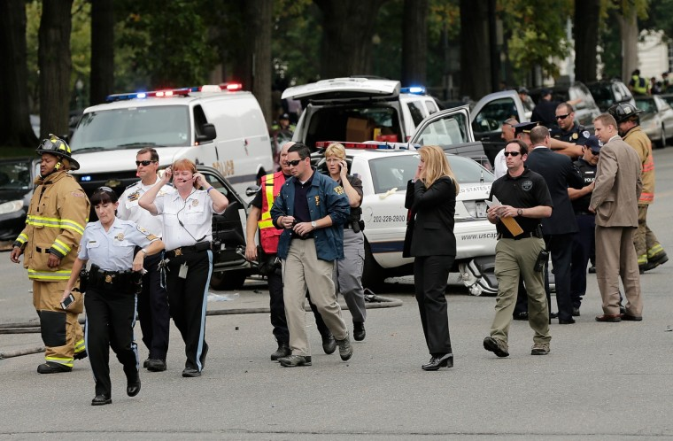 Law enforcement personnel respond to an incident on Constitution Avenue outside the U.S. Capitol October 3, 2013 in Washington, DC. Capitol police locked down the facility during the incident. (Win McNamee/Getty Images)