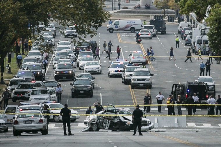 A police car that struck a barricade blocks Constitution Avenue as U.S. Capitol Police investigate a shooting outside of the U.S. Capitol on October 3, 2013 in Washington, DC. Police called the shooting an isolated incident, unassociated with any act of terrorism. (T.J. Kirkpatrick/Getty Images)