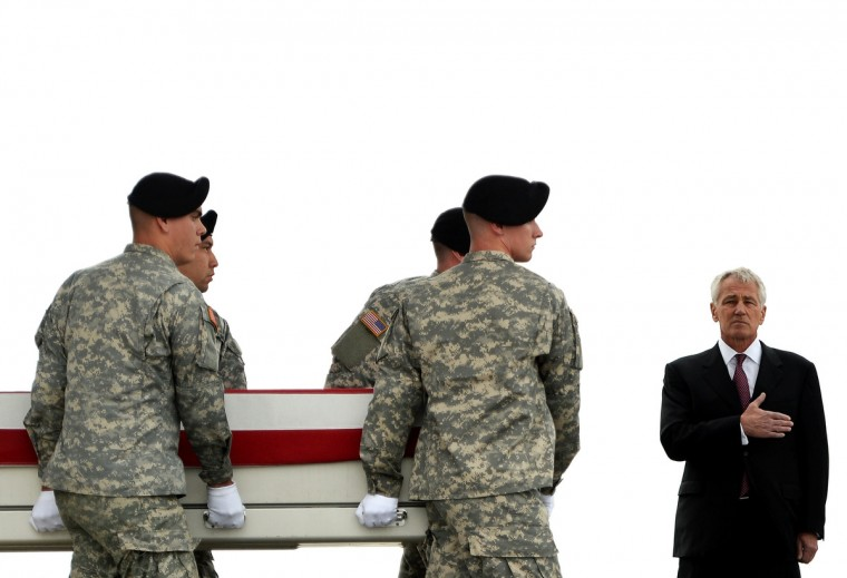 U.S. Secretary of Defense Chuck Hagel holds his hand over his heart as U.S Army soldiers carry the flag-draped transfer case containing the remains of U.S. Army Pfc. Cody J. Patterson during a dignified transfer at Dover Air Force Base in Dover, Delaware. According to reports, Patterson, who was from Philomath, Oregon, assigned to the 3rd Battalion, 75th Ranger Regiment, at Fort Benning, Georgia, was killed while supporting Operation Enduring Freedom - Afghanistan. Since the U.S. government shutdown, a benefit called the 'death gratuity' that helps families cover travel and funeral costs for fallen soldiers has gone unpaid. (Patrick Smith/Getty Images)