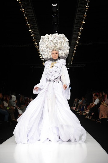 A model showcases designs by Fenny Mustafa on the runway at the Queen of Scarf show during Jakarta Fashion Week 2014 at Senayan City in Jakarta, Indonesia. (Robertus Pudyanto/Getty Images)