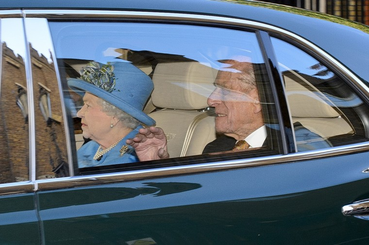 Queen Elizabeth II and Prince Philip, Duke of Edinburgh arrive to attend the christening of HRH Prince George Of Cambridge at St James's Palace on October 23, 2013 in London, England. (Ben A. Pruchnie/Getty Images)