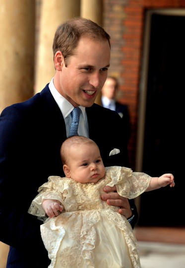 Prince William, Duke of Cambridge arrives, holding his son Prince George, at Chapel Royal in St James's Palace, ahead of the christening of the three month-old Prince George of Cambridge by the Archbishop of Canterbury on October 23, 2013 in London, England. (Pool/Getty Images)