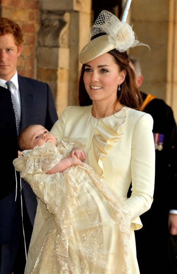 Catherine, Duchess of Cambridge carries her son Prince George Of Cambridge after his christening at the Chapel Royal in St James's Palace, ahead of the christening of the three month-old Prince George of Cambridge by the Archbishop of Canterbury on October 23, 2013 in London, England. (Pool/Getty Images)