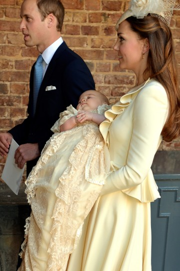 Catherine, Duchess of Cambridge carries her son Prince George Of Cambridge alongside the Prince William, Duke of Cambridge, following his christening at the Chapel Royal in St James's Palace, ahead of the christening of the three month-old Prince George of Cambridge by the Archbishop of Canterbury on October 23, 2013 in London, England. (Pool/Getty Images)