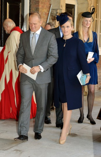 Godparent Zara Philips and husband Mike Tindall leave the Chapel Royal in St James's Palace, after the christening of the three month-old Prince George of Cambridge by the Archbishop of Canterbury in London, England. (Pool/Getty Images)