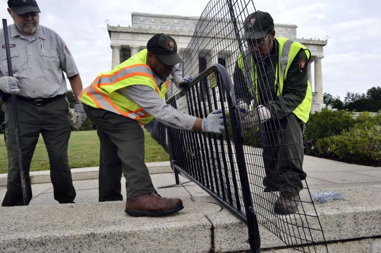 Park Service workers erect a barrier around the Lincoln Memorial in Washington, DC, on October 1, 2013. The US government shut down Tuesday for the first time in 17 years after a gridlocked Congress failed to reach a federal budget deal amid bitter brinkmanship. (Jewel Samad/Getty images)