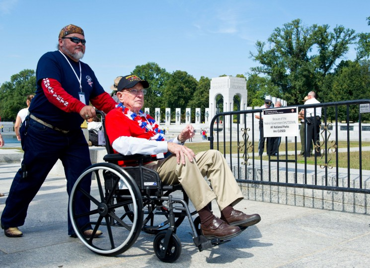 A US World War II veteran visits the World War II Memorial on the National Mall in Washington, DC, on October 1, 2013. The US Park Service opened the area to the veterans who are brought to Washington to visit and reflect at their memorials. (Karen Bleier/Getty images)