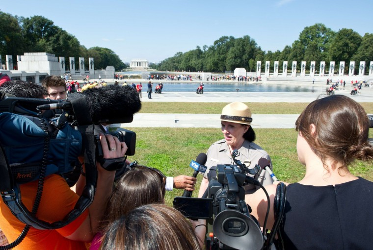 US National Park Service spokeswoman Carol B. Johnson speaks to reporters as the World War II Memorial is opened to military war veterans on the National Mall in Washington, DC, on October 1, 2013. The US Park Service opened the area to the veterans who are brought to Washington to visit and reflect at their memorials. (Karen Bleier/Getty images)
