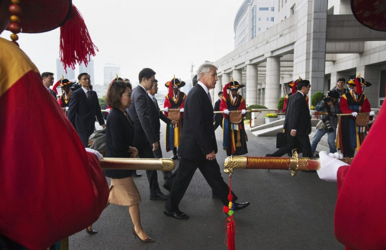US Secretary of Defense Chuck Hagel (C) enters the Ministry of National Defense during an honor guard ceremony in Seoul. After meetings in South Korea on October 2, US Secretary of State John Kerry and Defense Secretary Chuck Hagel will head to Tokyo for two-plus-two security talks with Japan. (Jacquelyn Martin/Getty Images)