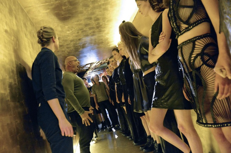 Models listen instructions of French photographer Jean-Baptiste Mondino (2ndL) before the start of the Iris Van Herpen 2014 Spring/Summer ready-to-wear collection fashion show, on October 1, 2013 in Paris. (Miguel Medina/Getty Images)