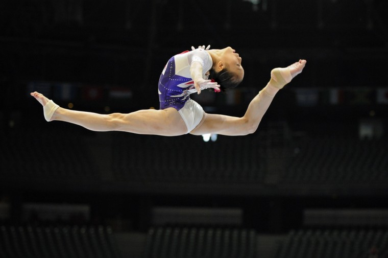 China's Yao Jinnan competes on uneven bars at the 44th Artistic Gymnastics World Championships in Antwerp. (John Thys/Getty Images)