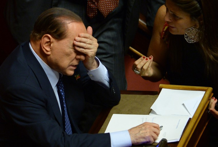 "Former Prime Minister and leader of Forza Italia, Silvio Berlusconi gestures at the Senate in Rome before today's Prime Minister Enrico Letta's confidence vote at the Parliament. Enrico Letta warned lawmakers ahead of a crucial vote of confidence today that the country ran a ""fatal"" risk as Silvio Berlusconi tries to topple his government. ""Italy runs a risk that could be a fatal risk. Seizing this moment or not depends on us, on a yes or a no,"" Letta said in his address. (Filippo Monteforte/Getty Images)"
