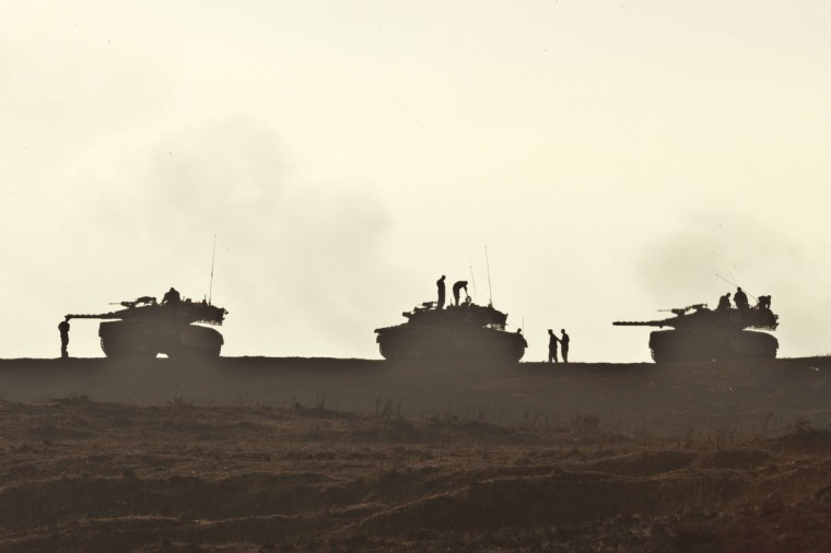 Israeli soldiers are silhouetted next to their tanks during a military exercise near the northern border with Syria in the Israeli-annexed Golan Heights. The Golan has been tense since the 2011 start of the conflict in Syria, but so far there have only been minor flare-ups as Syrian small arms fire or mortar rounds hit the Israeli side, prompting an occasional response by Israel, which seized 1,200 square kilometres (460 square miles) of the strategic plateau during the 1967 Six Day War. (Jack Guez/Getty Images)