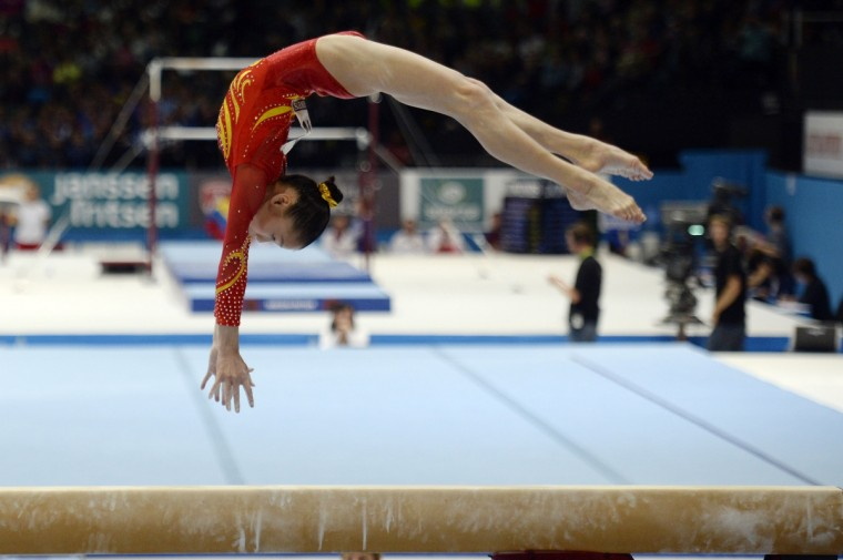 China's gymnast Chunsong Shang competes in the balance beam qualifications at the 44th Artistic Gymnastics World Championships in Antwerp. (Martin Bureau/Getty Images)