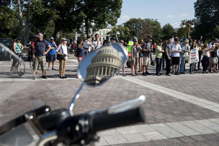 US Capitol Police keep people at a distance as they listen as House Democrats speak about the government shutdown on Capitol Hill in Washington, DC. The US government is in a forced shutdown after lawmakers failed to pass a spending bill. (Brendan Smialowski /Getty images)