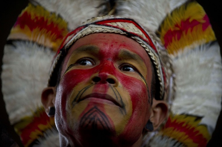 Indigenous Brazilians march along Paulista Avenue in Sao Paulo, Brazil on, at the beginning of the National Indigenous Mobilization Week. Indigenous people from several ethnic groups take part in a protest to demand more support from the federal government. (Nelson Almeida/Getty images)