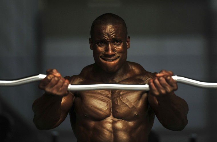 Body builder Robert Timms warms up before going on stage during the Muscle Mania Fitness Korea Competition in Seoul. Chosen bodybuilders from the competition will be able to participate in the Fitness Universe Competition in the next year. (Truth Leema/Getty images)