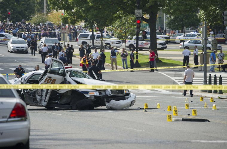 "A police cruiser is wrecked after shots fired were reported near 2nd Street NW and Constitution Avenue on Capitol Hill in Washington, DC, on October 3, 2013. The US Capitol was placed on security lockdown Thursday after shots were fired outside the complex, senators said. ""Shots fired outside the Capitol. We are in temporary lock down,"" Senator Claire McCaskill said on Twitter. Police were seen running within the Capitol building and outside as vehicles swarmed to the scene. (Jim Watson/Getty Images)"