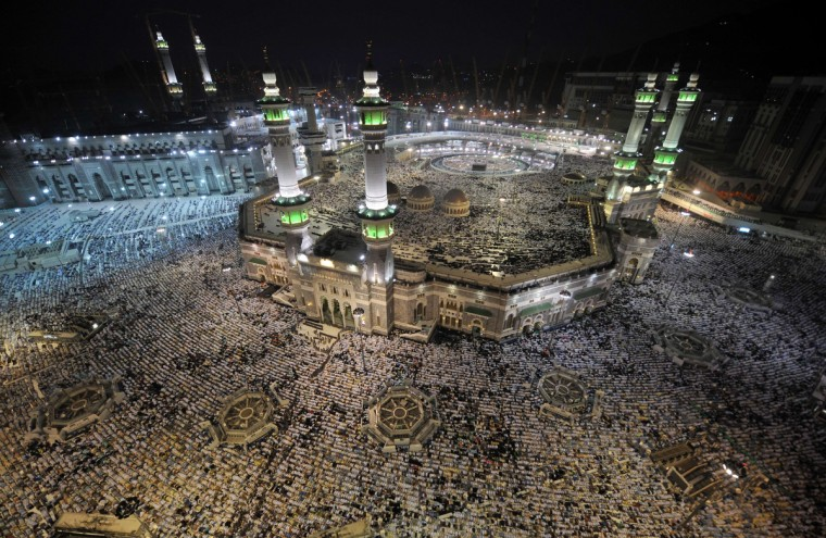 A general view shows pilgrims performing evening prayers in Mecca's Grand Mosque as more than two million Muslims have arrived in the holy city for the annual hajj pilgrimage. The hajj, which is one of the world's largest human assembly, begins on October 13 amid concerns over the deadly MERS coronavirus. (Fayez Nureldine/Getty Images)