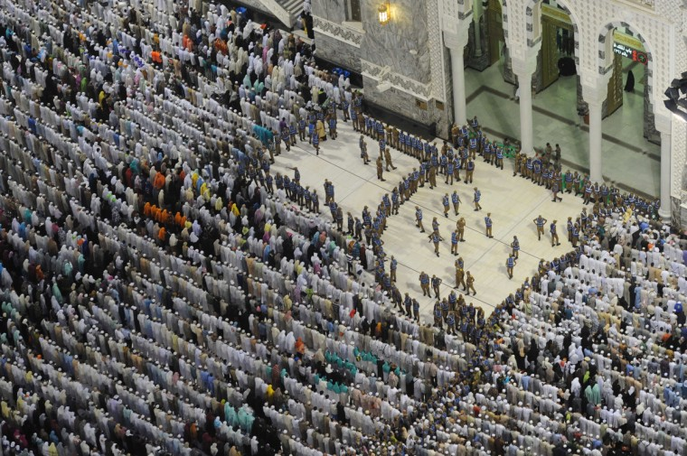 A general view shows security standing guard while pilgrims perform evening prayers in Mecca's Grand Mosque, on October 8, 2013, as more than two million Muslims have arrived in the holy city for the annual hajj pilgrimage. The hajj, which is one of the world's largest human assembly, begins on October 13 amid concerns over the deadly MERS coronavirus. (Fayez Nureldine/Getty Images)