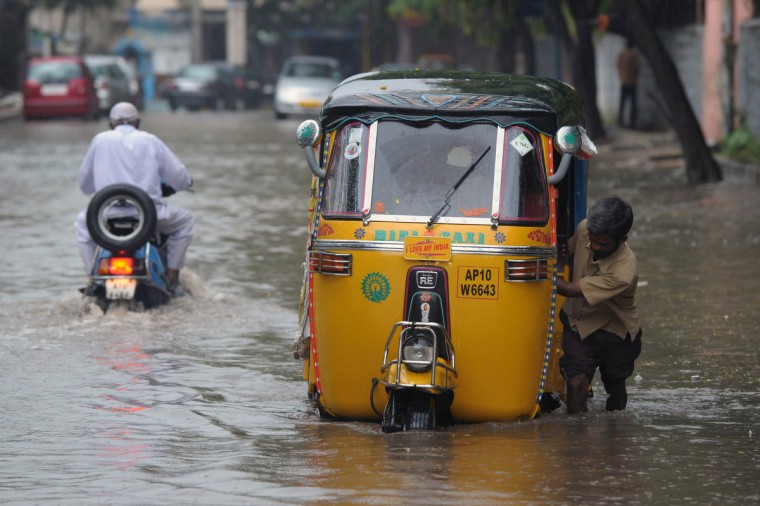 An Indian auto-rickshaw driver pushes his three wheeler through water logged streets during heavy rains in Hyderabad. Andhra Pradesh and Orissa coast are to be on high alert as a depression formed over the Bay of Bengal could intensify into a cyclonic storm and hit the state coast. A few places will experience heavy rainfall during the next two days, the Meteorological Centre reports. (Noah Seelam/Getty Images)
