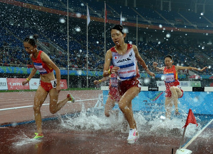 Misaki Sango of Japan (C) leads the Womens 3000m Steeplechase before finishing in second place during the East Asian Games held at the Tianjin Olympic Center Stadium in Tianjin. The East Asian Games which are held every four years see nine countries including China, Japan, South and North Korea participating in 262 events in 22 different sports. (Mark Ralsron/Getty Images)