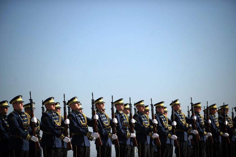 Kosovo honour guards stand guard during a ceremony for the arrival of Turkish Prime Minister Recep Tayip Erdogan near the town of Sllatina. Erdogan is on official visit to Kosovo. (Armend Nimani/Getty Images)