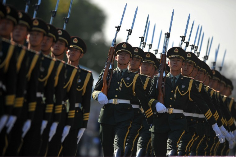 Chinese honor guards prepare for the arrivial of India's Prime Minister Manmohan Singh and Chinese premier Li Keqiang outside the Great Hall of the People in Beijing. Manmohan Singh is on a visit to China from October 22 to 24. (Wang Zhao/Getty Images)