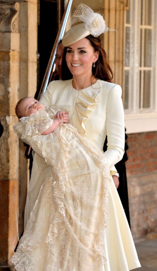 Catherine, Duchess of Cambridge, holds her son Prince George of Cambridge following his Christening at Chapel Royal in St James's Palace in central London. (Pool/Getty Images)
