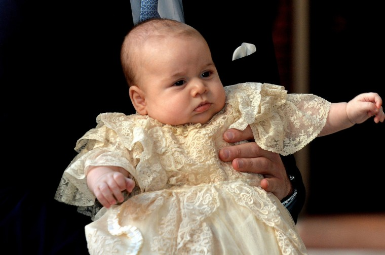 Britain's Prince William, Duke of Cambridge holds his son, Prince George of Cambridge, as he arrives at Chapel Royal in St James's Palace in central London for the christening of the three month-old baby. (Pool/Getty Images)