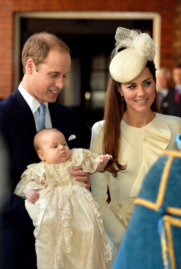 Britain's Prince William, Duke of Cambridge and his wife Catherine, Duchess of Cambridge, arrive with their son Prince George of Cambridge at Chapel Royal in St James's Palace in central London on October 23, 2013, ahead of the christening of the three month-old prince. (Pool/Getty Images)