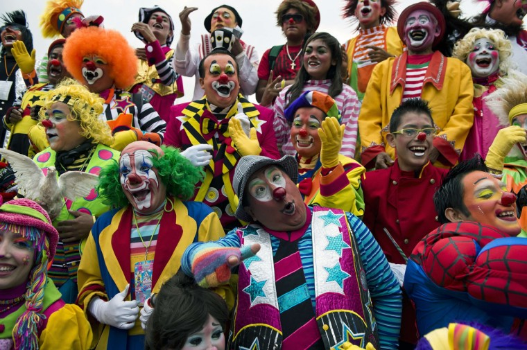 A group of clowns smile during a family photo for the Latin American Clown Convention in Mexico City. At least 500 clowns from Peru, Belize, Nicaragua, Honduras and Costa Rica are taking part in the event. (Ronaldo Schemidt/Getty Images)